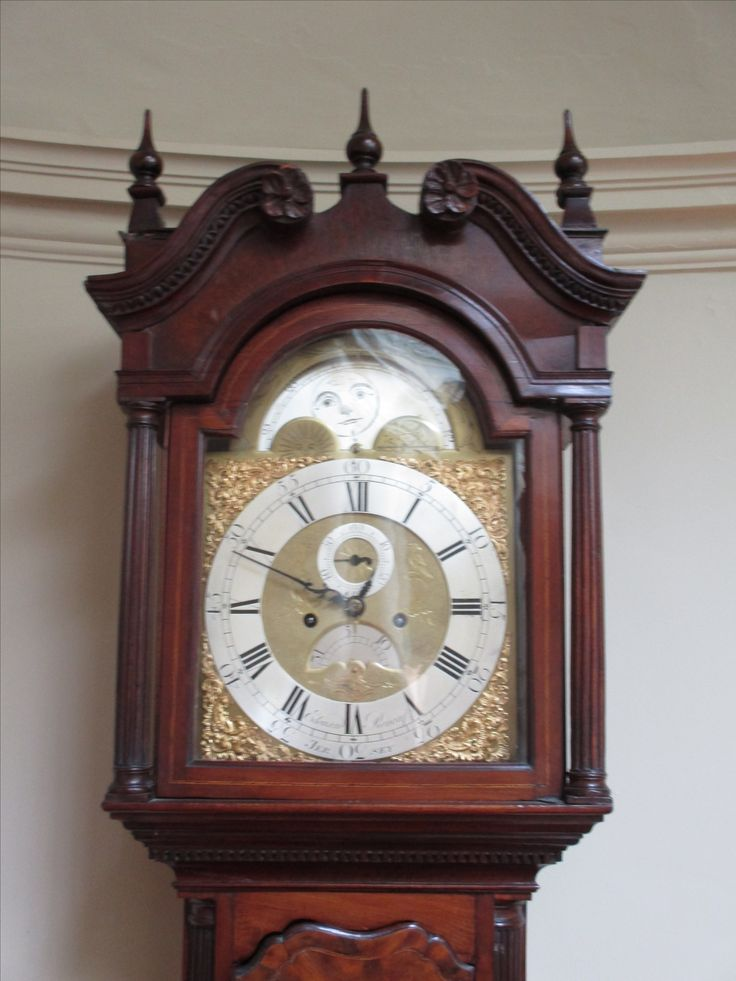 Mahogany longcase clock.  8-day movement.  Silver roman chapter ring with moonphases to arch. Channel Islands, mid-18th century.  Maker: Edouard Renouf, Jersey.  Located on the Eisenhower Gallery, Culzean Castle.