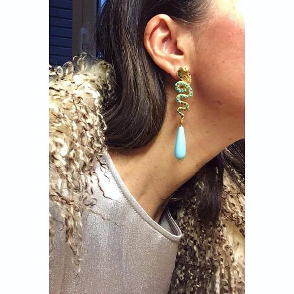 Our statement Nuwa earrings with a turquoise resin drop, adorned with malachite, chaolite and crystals. It is the perfect accessory for evening wear.