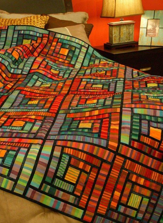 Stained Glass Cabins by Vivian Ritter. Woven stripe fabrics by Kaffee Fassett for Rowan Fabrics. Best Traditions with a Twist Quilts 2015 at Quilters Newsletter.
