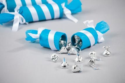 fill old toilet paper rolls with candy and wrap up! cute!