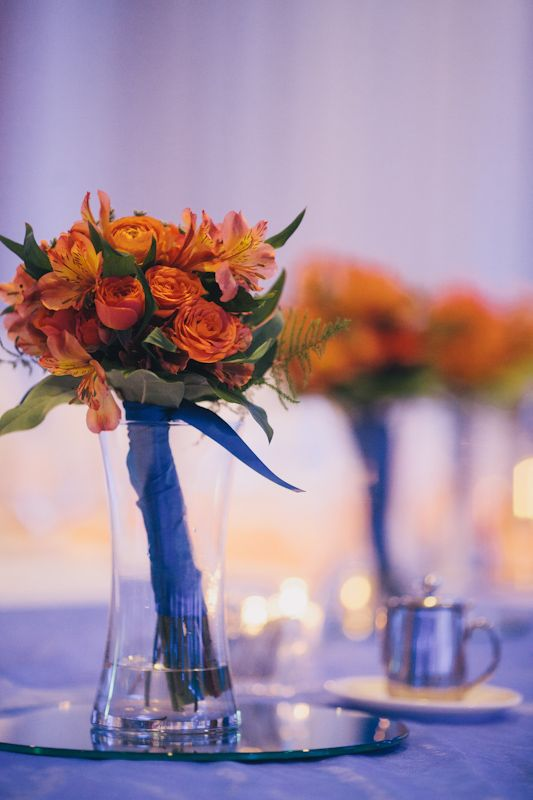 Orange alstroemeria bridesmaid bouquets.  Flowers by Amie Flaherty, photo courtesy of Gunnar Cook Photography