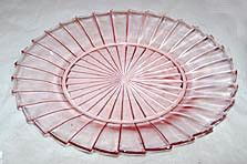 These are Depression Glass dinner plates in the Sierra or Pinwheel pattern made by Jeannette. They measure 9 inches across and are in wonderful condition. I do not believe they have been used much if