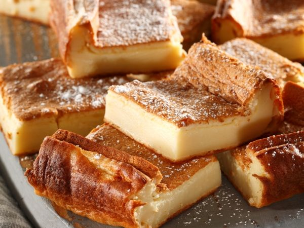 Crustless Milk Tart Slices:  The creamy, velvety texture will have everybody hooked in one bite.