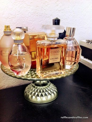 Cake plate pedestal in the bathroom.. how pretty! Perfect way to organize perfumes and lotions on a vanity or bathroom counter.
