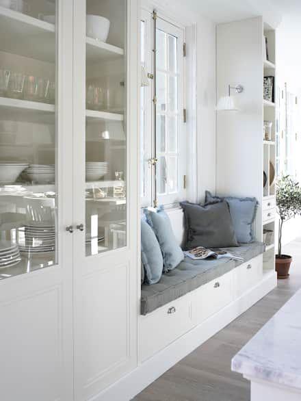 Banco, para tener un luminoso rincón de estar: Cocinas de estilo rústico de DEULONDER arquitectura domestica