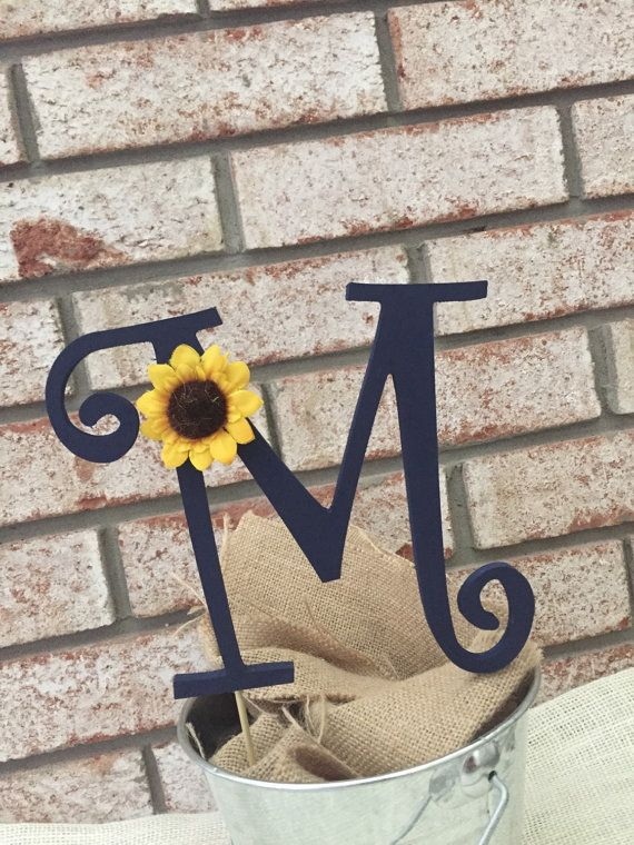 This 6 wooden monogram cake topper is hand painted navy blue and embellished with a mini sunflower. This cake topper would be perfect finish for