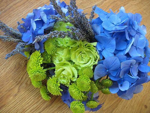 This might be a good color combo for spring or summer. Green roses and button mums, blue hydrangea and lavendar, very pretty.