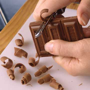 chocolate curling techniques; small & large curls- you do NOT need to use Hershey's, which has been linked 76% of the time to slave labor...  Divine chocolate would be a great sub here...