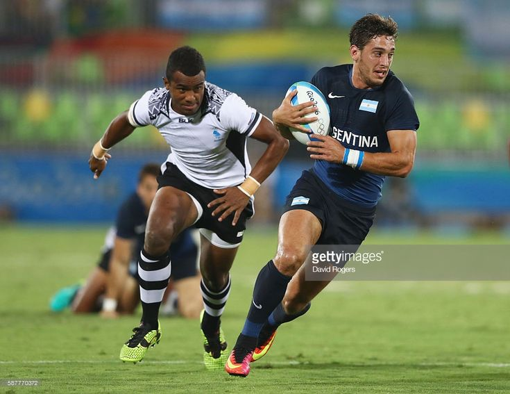 Bautista Ezcurra of Argentina breaks through during the Men's Rugby Sevens Pool A match between Fiji and Argentina on Day 4 of the Rio 2016 Olympic Games at Deodoro Stadium on August 9, 2016 in Rio de Janeiro, Brazil.  (Photo by David Rogers/Getty Images)