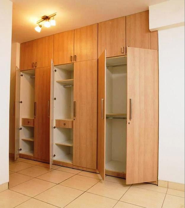 Woodwork Designs build around the window. simple design bedroom wardrobe designs