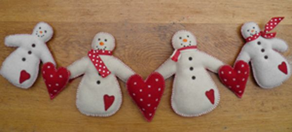 A fun and whimsical felt garland of a family of snowmen with warm hearts.