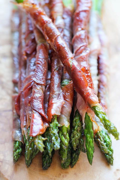 Prosciutto Wrapped Asparagus Because nothing makes a vegetable more tempting than wrapping it in a piece of bacon.