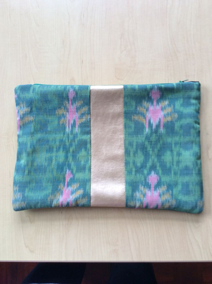 Ikat design in Green with gold vinyl stripe zipped pouch