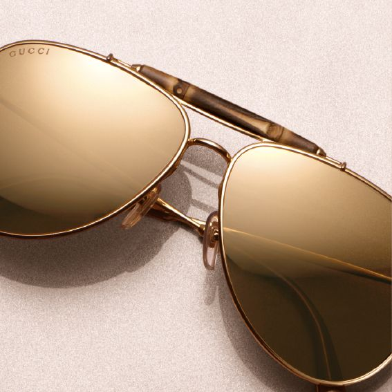 Signature Gucci bamboo hardware, 24-karat gold-plated frames and a timeless shape make these aviators impossible to resist.