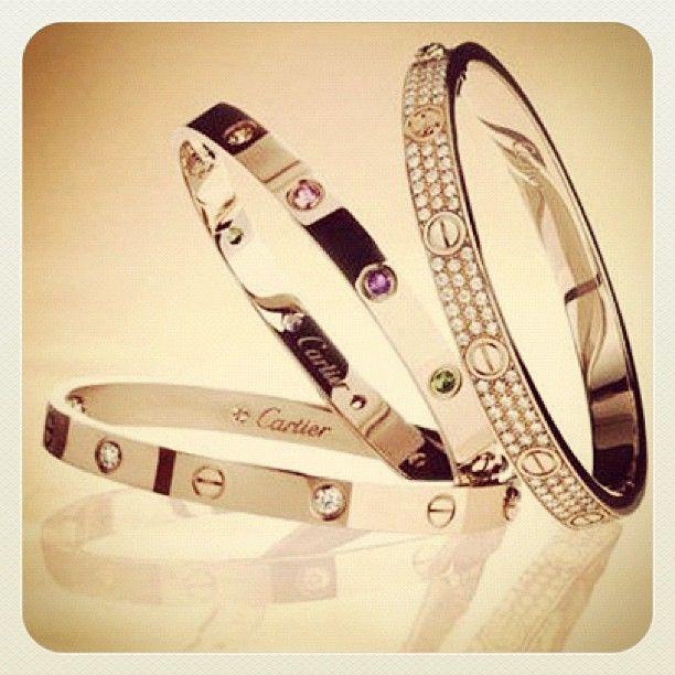 Cartier LOVE bracelets. Gold & Diamonds