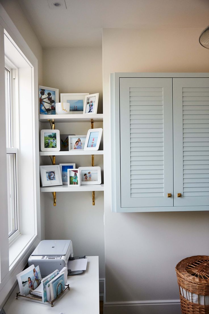 Open Shelving With Framed Photos Make Use Of An Awkward Nook