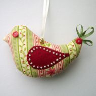 This is a beautiful handmade Christmas decoration to adorn a tree or anywhere in your home. The bird is made from a lovely festive print fabric, complete with an appliqued wing with bead detail and ribbon tail. It has an ivory ribbon hanging loop which...