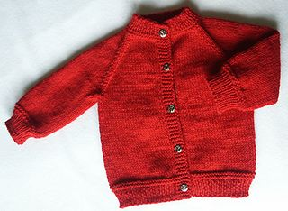 "From pattern: ""This is a seamless raglan cardigan knit from the top down. It measures a generous 20"" around closed across the tummy and about 10"" neck to bottom-about a 4 to 10 month size."""