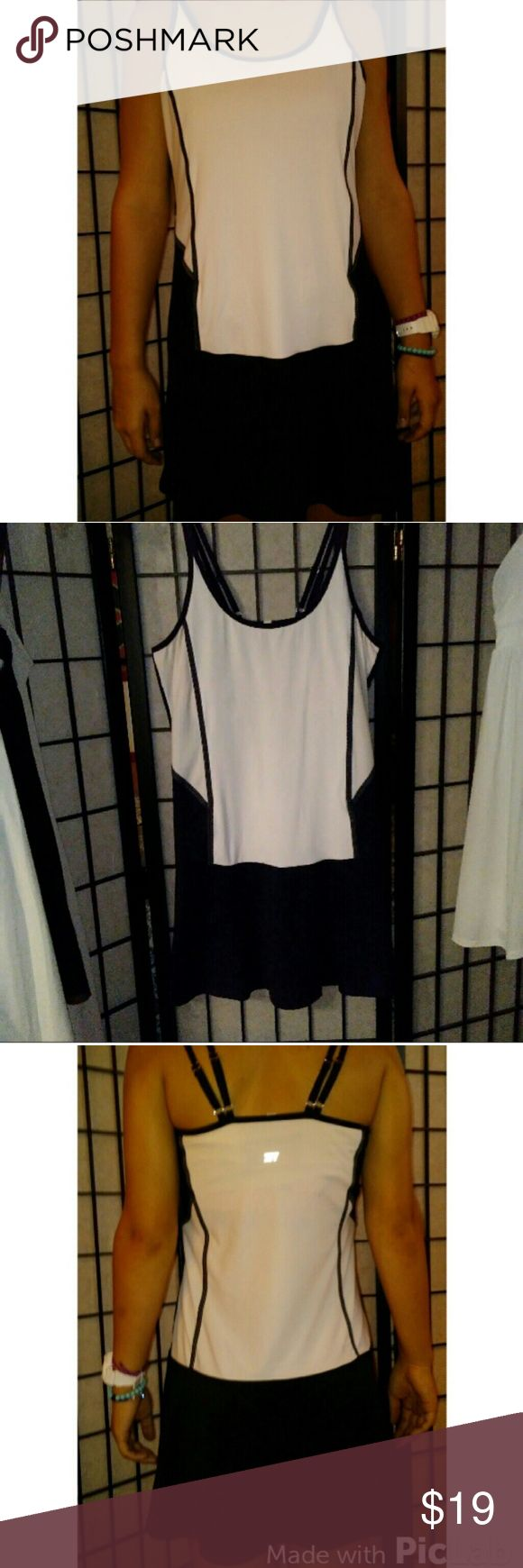 The dress is white - Tail Black White Tennis Dress