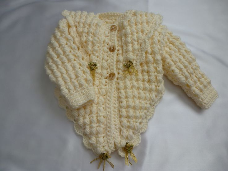 Crochet cardigan. This has pointed fronts & on the back it comes to a point on the collar.