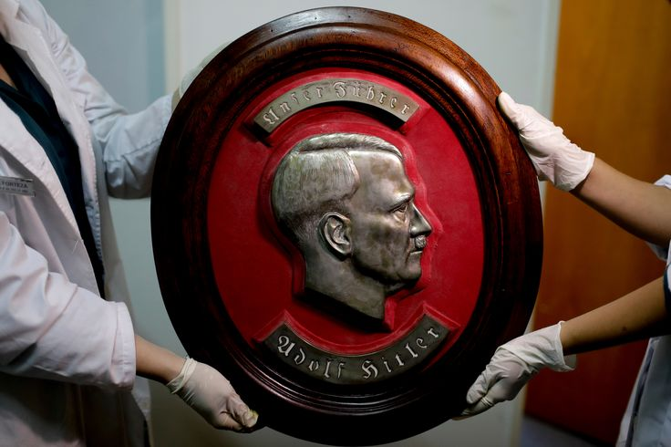 Federal Police Show a Bust Relief Portrait of Nazi leader Adolf Hitler at the Interpol headquarters in Buenos Aires Argentina [5250 x 3500]