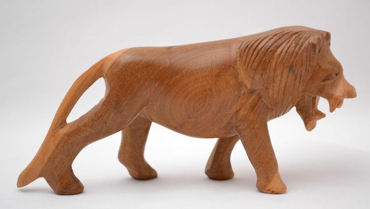 Handmade wood carving carved wooden lion animal africa