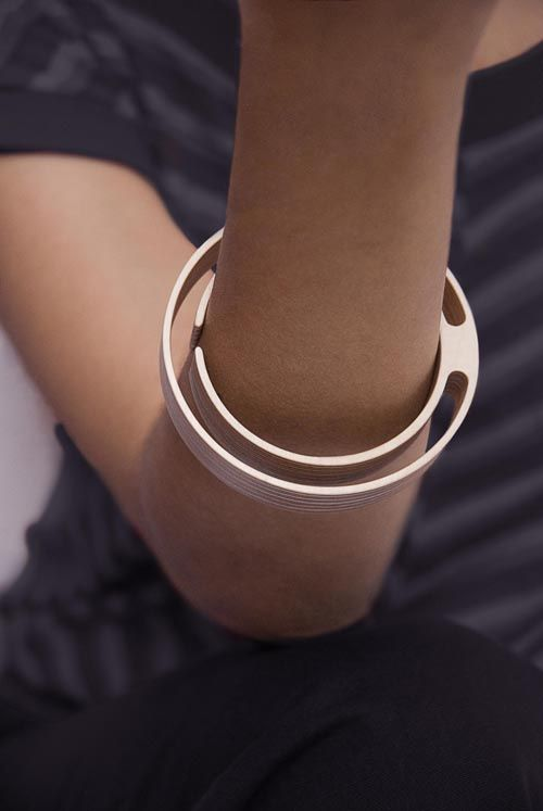 "Wooden bracelet - playwood and laminated, industrial production processes, lightweight, flexible, quiet and warm objects - ""Quiet Wood"", 2012, Jewelry for Klimt02 Gallery by Emiliana Design, Barcelona (Ana Mir and Emili Padrós)"