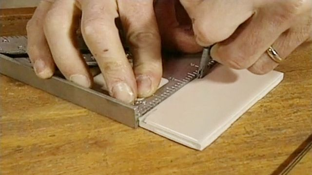 Find out how to cut ceramic tile by hand using a glass cutter, square, and wire clothes hanger. Watch this video to find out more.
