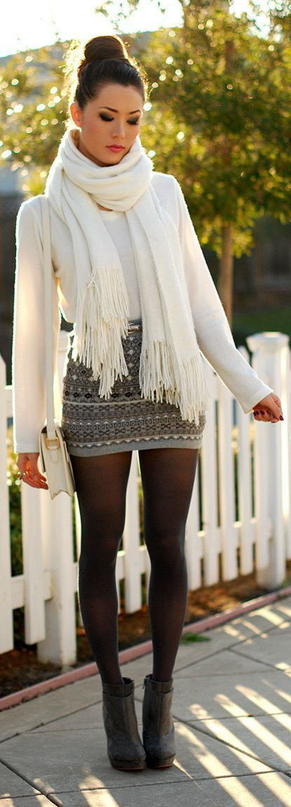 Opt for a white crew-neck jumper and a grey christmas mini skirt for a glam and trendy getup. Polish off the ensemble with charcoal suede booties.  Shop this look for $175:  http://lookastic.com/women/looks/ankle-boots-tights-crossbody-bag-mini-skirt-scarf-crew-neck-sweater/4518  — Charcoal Suede Ankle Boots  — Black Wool Tights  — White Leather Crossbody Bag  — Grey Fair Isle Mini Skirt  — White Scarf  — White Crew-neck Sweater