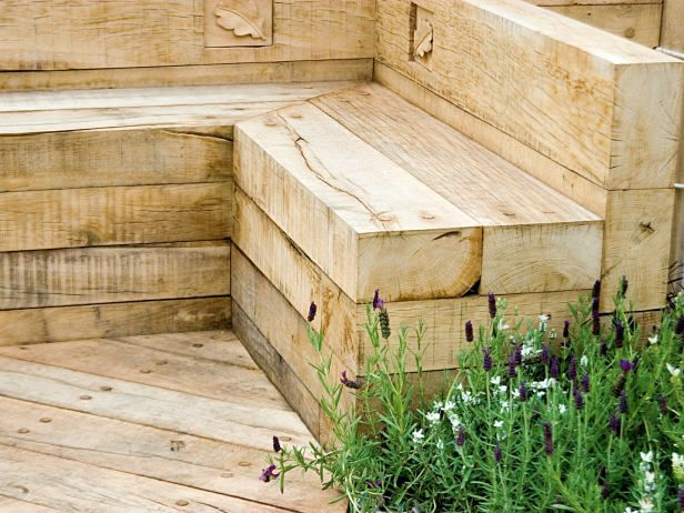 Stacked timbers were used to create a simple built in garden bench, which can also be used to display flowering pots during the summer.