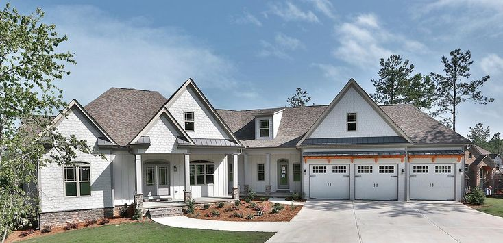 This split bedroom Craftsman house plan has an attractive exterior with a blend of shingles and board and batten siding. The garage is angled slightly and has a shed roof extending off the front with wood supports.The foyer gives you views extending to the back of the home across the family room. Columns help define the dining room to your right.The main portion of the first floor is open concept. From your kitchen you have views to the fireplace across the family room, the breakfast room…