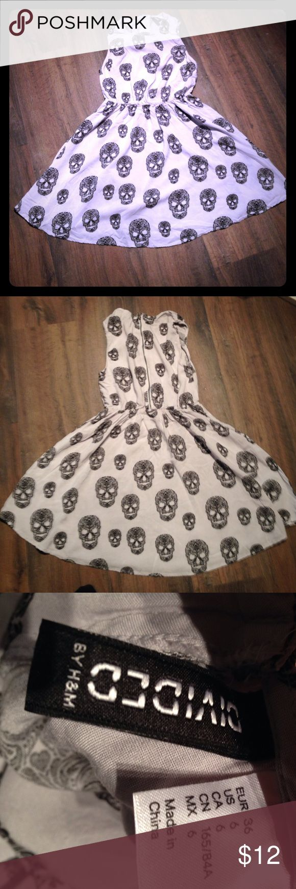 H&M Divided Sugar Skull Dress Cute sugar skull dress 100% viscose. About 30 inches long about 15 inches across underarm. Stretchy waist. Zipper and button closure has extra button on care tag seems to run pretty small. Noticed some pulled threads, one pictured Divided Dresses
