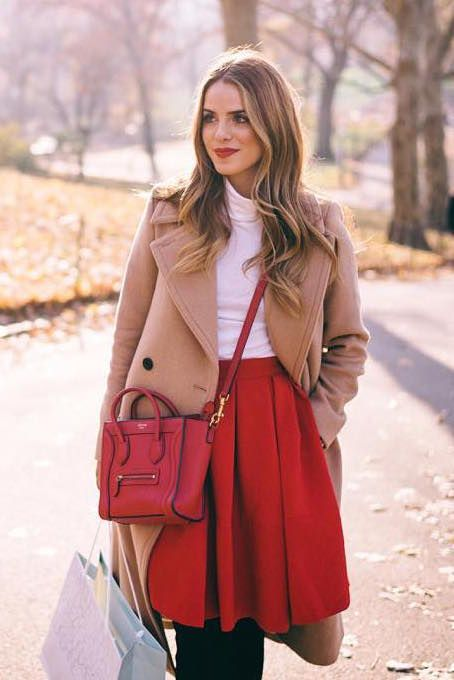 This red pleated skirt is a great pick for the holidays. Julie Hengel styles it with a white turtleneck and our long double-breasted camel coat | Banana Republic