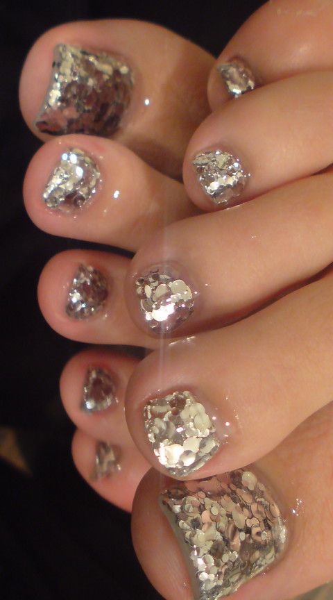 Pretty pedicure: Silver Glitter polish (Gel?) looks like a disco ball!