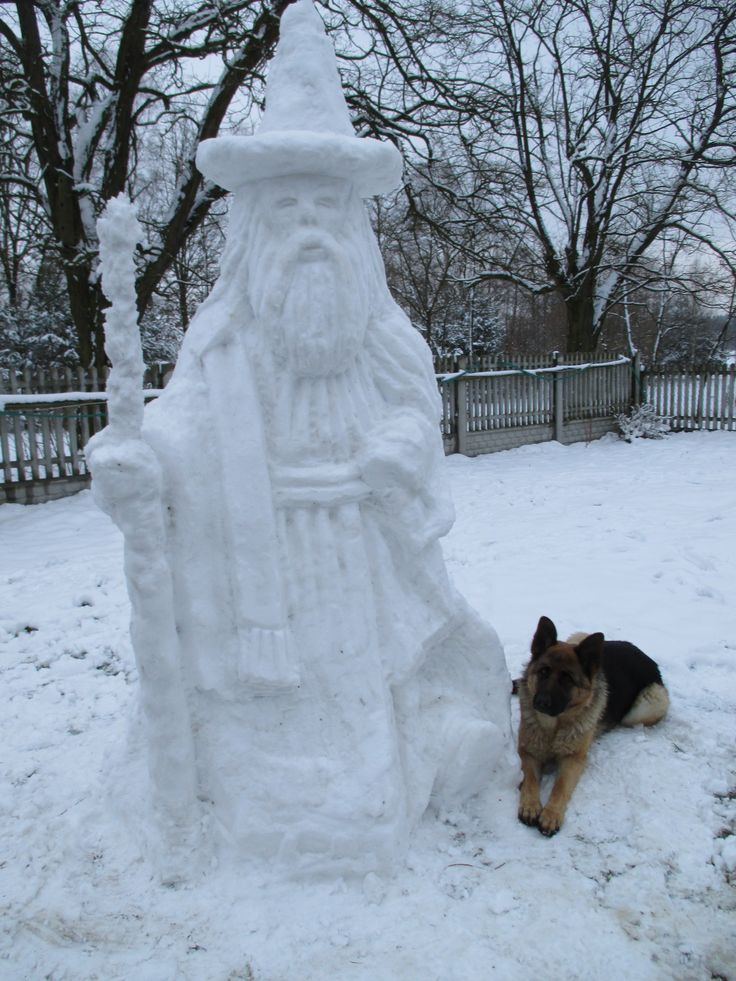 Gandalf sculpture molded from snow - with a dog.