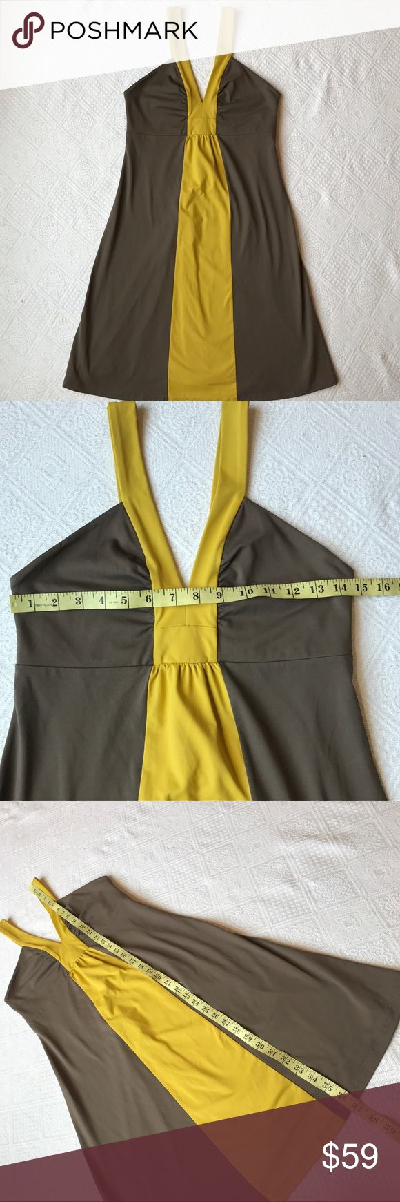 Patagonia Dress size medium flattering color block This dress is a great fabric. Super comfortable and durable for movement. 86% nylon. Flattering color block design. Patagonia Dresses