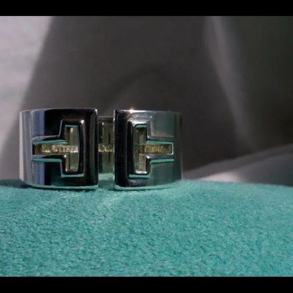 "cb32f4503 Tiffany & Co. Silver ""T"" Cutout Band Ring Tiffany & Co. describes ..."