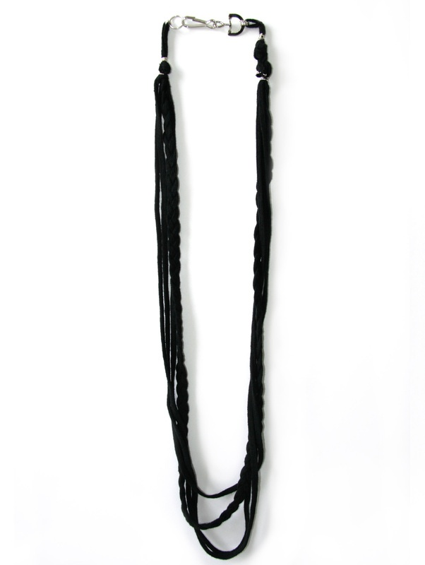 Alley Cat:NL30 $40 A long black rope necklace with oversized base metal back neck clasp