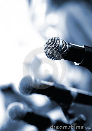 Stock Photo: Microphone on abstract blurred background (shallow DoF)