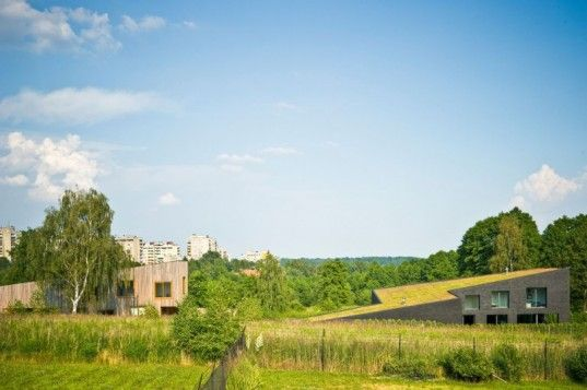 Modern Green-Roofed Homes Blend Into Poland's Countryside