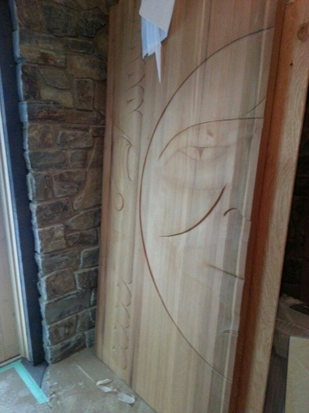 Beautiful hand carved doors created by a talented salish carver for one of my clients