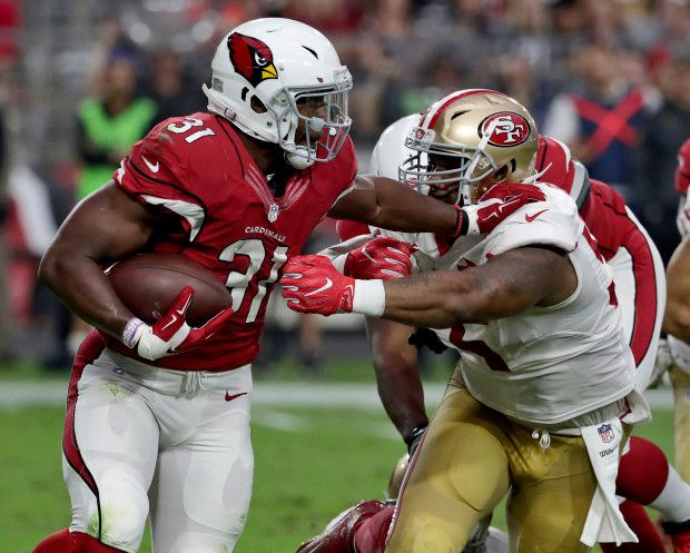 49ers vs. Cardinals:  23-20, Cardinals  -  November 13, 2016  -    Arizona Cardinals running back David Johnson (31) is hit by San Francisco 49ers outside linebacker Ahmad Brooks (55) during the second half of an NFL football game, Sunday, Nov. 13, 2016, in Glendale, Ariz. (AP Photo/Rick Scuteri)