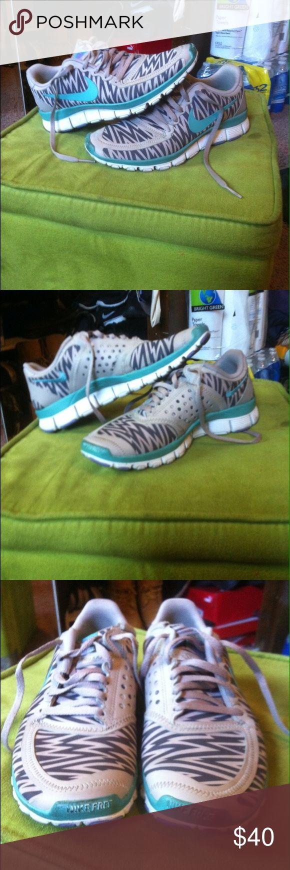 NIKE FREE 5.0 Nike running shoes / Women's Size 6 / gray & black striped w blue swoosh. Good Used condition, still look good & wearable !! Nike Shoes Athletic Shoes