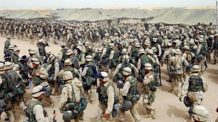U.S. Marines in northern Kuwait gear up after receiving orders to cross the Iraqi border on March 20, 2003. It has been more than 10 years since the American-led invasion of Iraq that toppled the regime of Saddam Hussein.