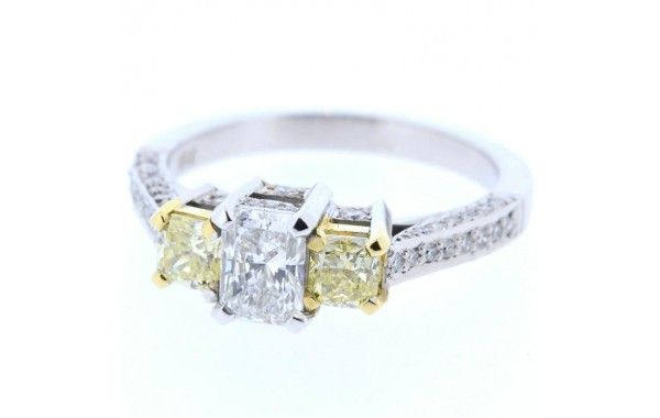 18ct white gold diamond ring, featuring a centre radiant cut diamond, with a natural fancy diamond either side, and diamonds down the shoulders.