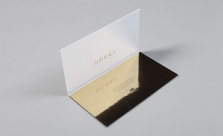 Notice the reflection of the Gucci logo on the mirrored gold surface