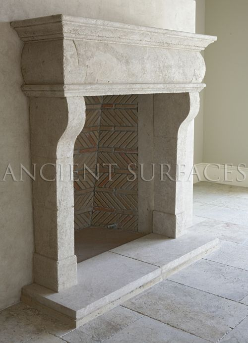 This Italian countryside fireplace was hand carved out of hard limestone installed with an interesting herringbone firebox and running bond brick lines.