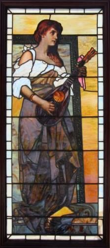 Stained Glass Window. A really magnificent window depicting a life size beauty playing the mandolin. From a Sutton Place South NYC estate. Condition: Good.