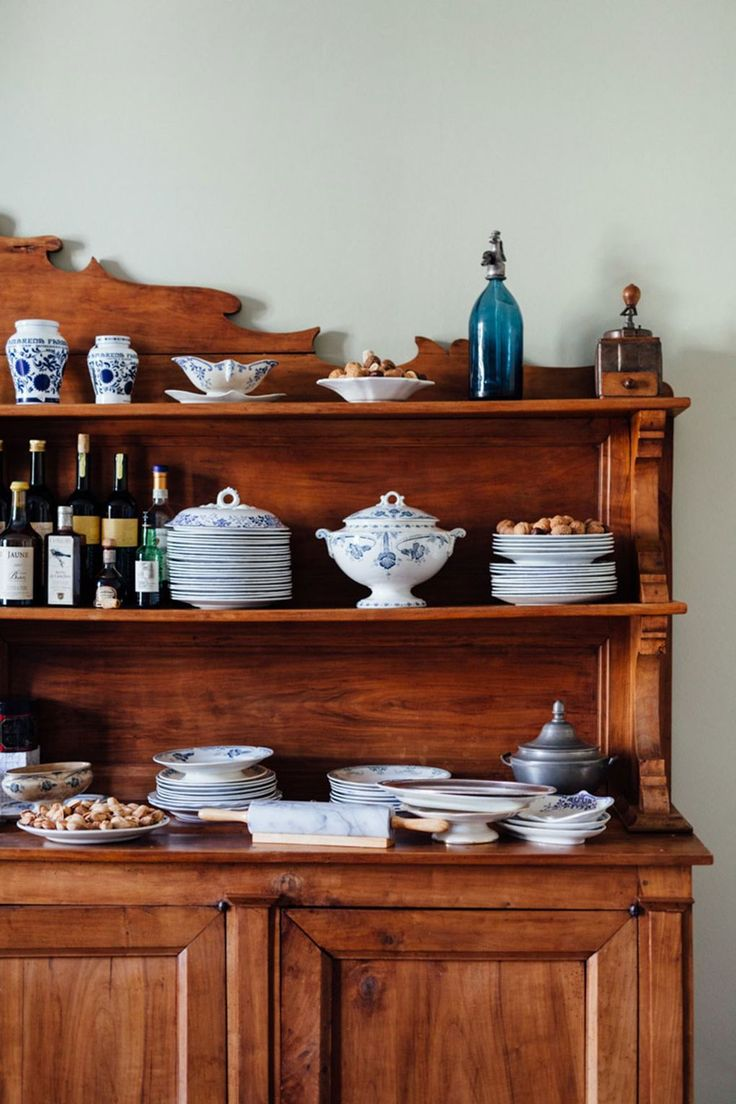 Wooden kitchen dresser in stylish kitchen ideas, traditional dresser with collections of crockery, country kitchen ideas, French farmhouse kitchen.