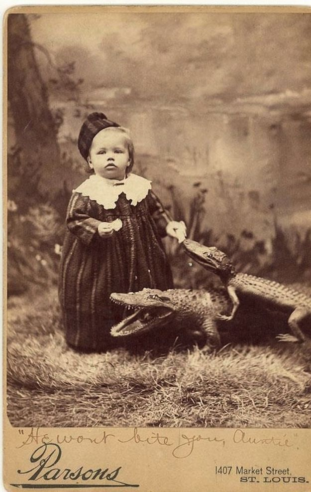 Baby and an alligator (or crocodile)  40 Black & White Photos That Cannot Be Explained